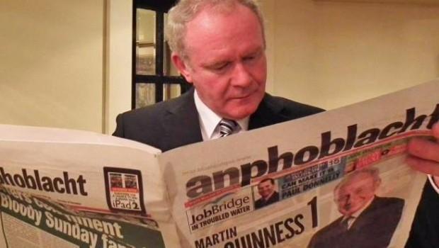 Martin_McGuinness_reading_a_copy_of_An_Phoblacht