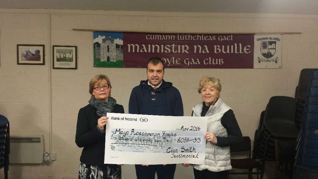 Photo of Cian Smith cheque presentations