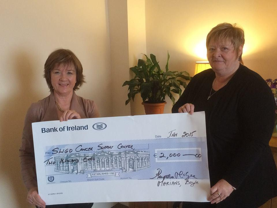 Photo of Cheque presentation from Marians