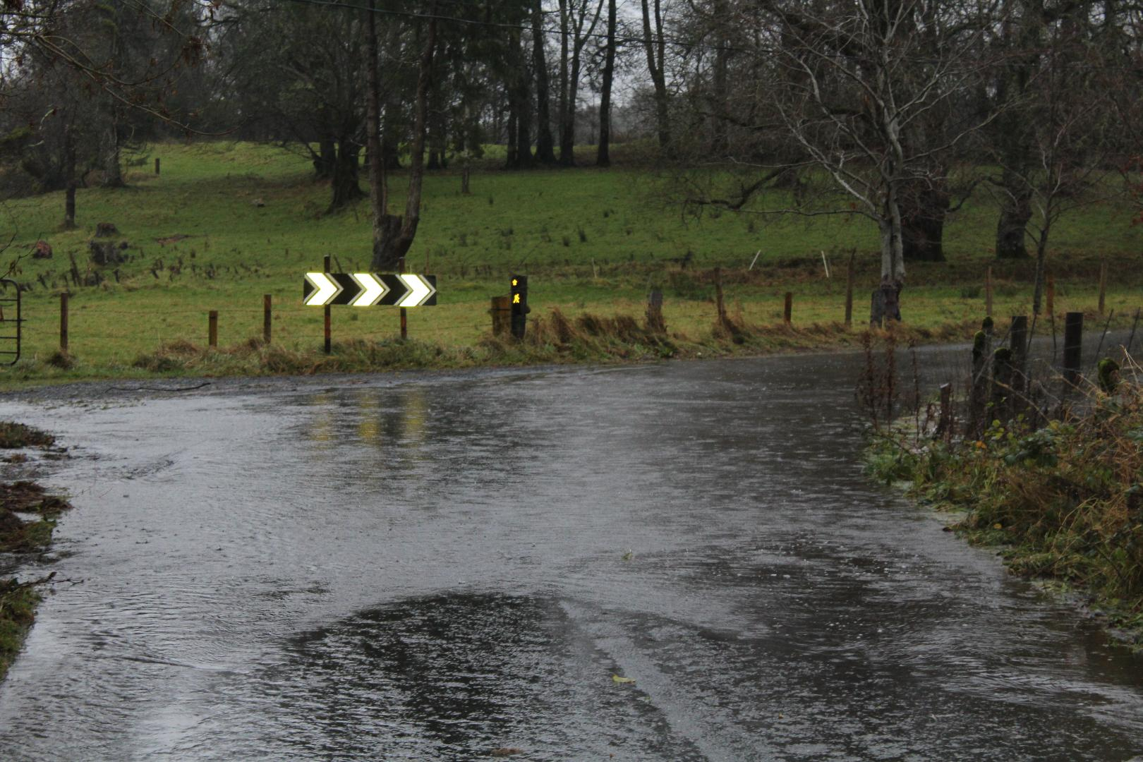 Photo of Roads closed as flood waters rise