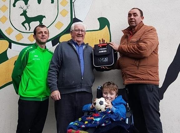 Photo of Defibrillator presentation to 'Celtic