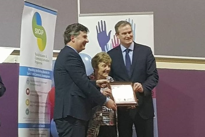 Photo of Mary is named Volunteer of the Year