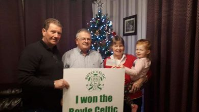 Photo of Pat and Mary receive their winning cheque
